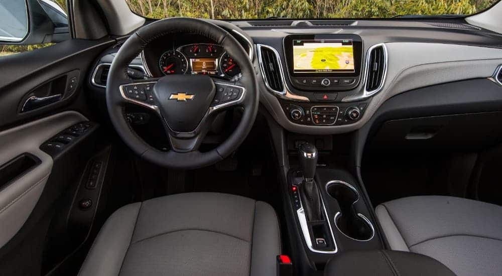 Instead of finding a Chevy dealer near you, try putting your keys in the cupholders, shown here in the interior of a 2020 Chevy Equinox.