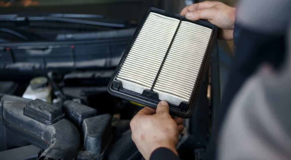 An air filter is being replaced during a Ford service near me.